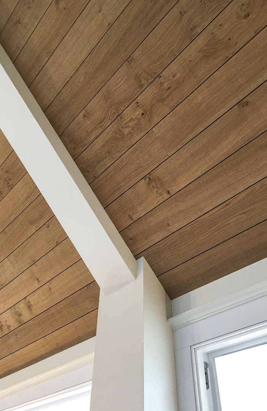 wood acoustic planks installed on a vaulted ceiling