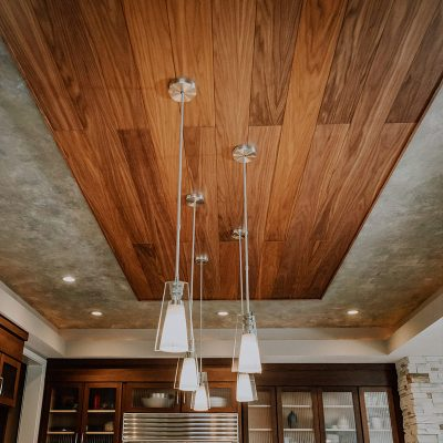 Walnut acoustic wood planks featured on a kitchen ceiling.