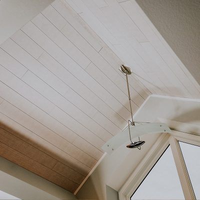 Vaulted ceiling featuring whitewash oak acoustic planks