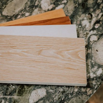 A variety of Timber Sound Acoustic Plank samples fanned out on a counter top.